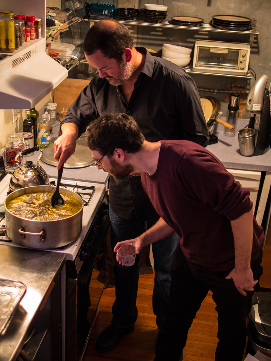 Rock Fish Stew Institute's Sam Stephenson and Ivan Weiss get a first taste of the stew.